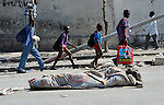In Port-au-Prince, a victim of Haiti's devastating January 12 earthquake lies on a public street in front of the Roman Catholic Cathedral of Our Lady of the Assumption on January 21.