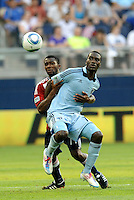 Sporting KC forward C.J Sapong (17) is tightly marked by Chivas USA defender Michael Lahoud... Sporting KC and Chivas USA played to a 1-1 tie at LIVESTRONG Sporting Park, Kansas City, Kansas.