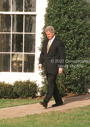 United States President Bill Clinton walks outside the Oval Office of the White House in Washington, D.C. to make a statement on the resignation of President Boris Yeltsin of Russia on December 31, 1999..Credit: Ron Sachs / CNP