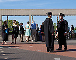 05/19/2013 - Medford/Somerville, MA - Justin McCallum, right, chats with Ezra Dunkle-Polier as graduating students and their families gather on Alex's Place before Phase I of Tufts University's 157th Commencement on Sunday, May 19, 2013. (Emily Zilm for Tufts University)
