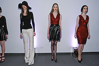 Models pose in an outfits from the Rosa Pusher Fall Winter 2012 collection presentation, by Tammy Pusher, during New York Fashion Week Fall 2012.