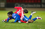 St Johnstone v Brechin....22.03.11  Scottish Cup Quarter Final replay.Collin Samuel is flattened by David McKenna.Picture by Graeme Hart..Copyright Perthshire Picture Agency.Tel: 01738 623350  Mobile: 07990 594431