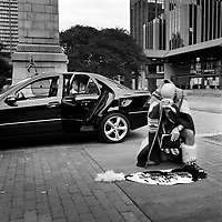 Ziggy, a white South African dressed in traditional Zulu clothing, leaves his car to give praise to the city and to the people working in the House of Legislature.