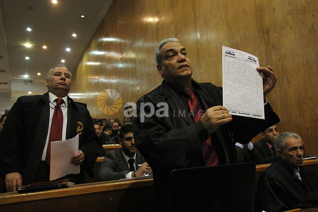The Lawyers of the 'Port Said Massacre' case, speaks during the trial of suspects in Cairo on December 23, 2014. The defendants were originally given sentences ranging from 15 years to life in prison. They were convicted of the murder of over 70 Ahly fans, nine security personnel and three officials from Al-Masry Club at a football match in Port Said in February 2012. Photo by Amr Sayed