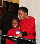 Actress and singer Rhonda Ross (Another World) and son Raif sing Christmas Carols - Hearts of Gold links to a better life celebrates Christmas with a party #2 for mothers and their children on December 17, 2016 in New York City, New York with arts and crafts, a great turkey dinner with all the goodies and then the children met Santa Claus and had a photo with him as he gave them gifts. (Photo by Sue Coflin/Max Photos)