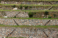Inca ruins of terraced walls in the Sacred Valley, Peru, South America.