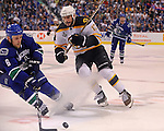 Vancouver and Boston vie for the puck during the third period in Game 2 of the Stanley Cup Finals in Vancouver, BC on Saturday, June 04, 2011. Staff photo by Christopher Evans