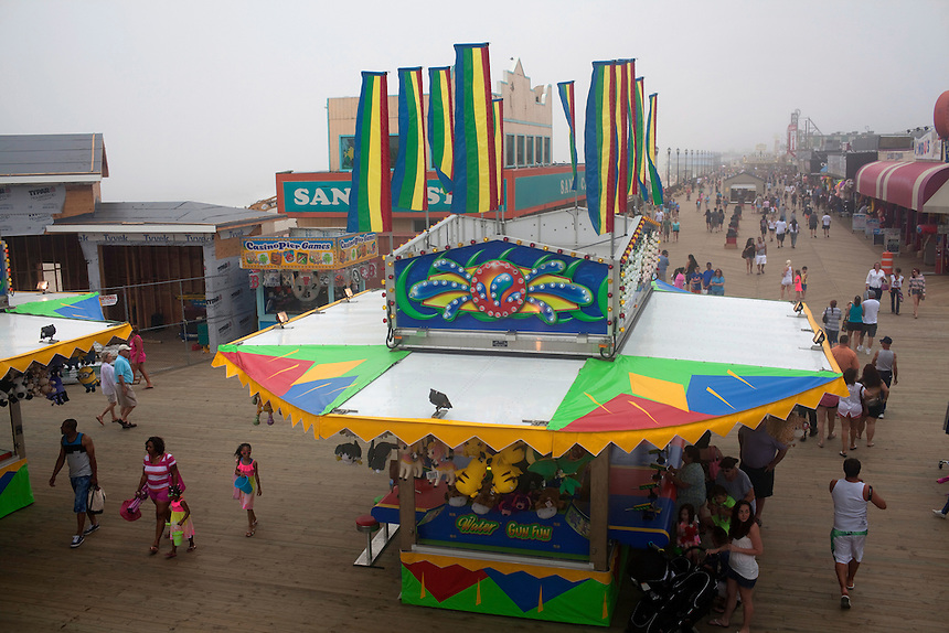 Seaside Heights, NJ - June 30, 2013 : The newly restored boardwalk near the Casino Pier that was partially destroyed by Superstorm Sandy at Seaside Heights, NJ on June 30, 2013. People are returning to the beaches for the summer after recovery efforts post Superstorm Sandy.