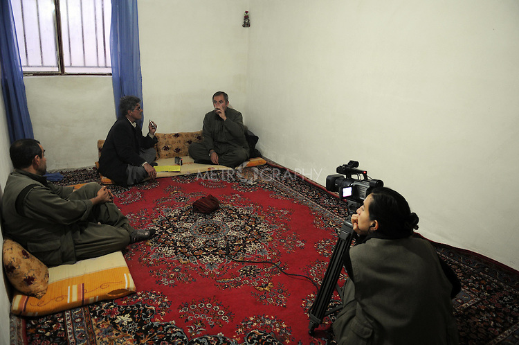 QANDIL, IRAQ:  PKK guerrillas monitor and film an interview conducted by an Iraqi Kurdish journalist in the Qandil mountains...The Kurdistan Workers' Party (PKK) is a pro-Kurdish party in Turkey deemed a terrorist group by the USA and the EU.  They are based in the Qandil mountains that make up the border between Iraq and Turkey...Photo by Kamaran/Najm