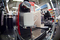 A Nespresso coffee maker is seen for sale in a Bed, Bath and Beyond store in New York on Monday, May 28, 2012.  Nespresso has recently announced that it will start advertising on television in the U.S. (© Richard B. Levine)