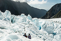 Two climbers enjoying looking into distance on Franz Josef Glacier, Westland National Park, West Coast, World Heritage Area, New Zealand