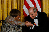 2016 Kennedy Center Honorees singers Mavis Staples and James Taylor cheer during a ceremony honoring the recipients, in the East Room of the White House, December 4, 2016, Washington, DC.  The 2016 honorees are: Argentine pianist Martha Argerich; rock band the Eagles; screen and stage actor Al Pacino; gospel and blues singer Mavis Staples; and musician James Taylor.<br /> Credit: Aude Guerrucci / Pool via CNP