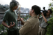 Romesh Gunesekera (left), a Sri Lankan born writer, ais interviewed by a local television crew during his day in Guangzhou as part of the Think UK Writers Train project. The Think UK China Writers Train is a project, in collaboration with the British Council, to take 4 UK writers/poets and 4 Chinese writers/poets around China by train visiting 6 major cities, in 17 days, to hold talks, seminars and readings of their work.