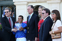 HALLANDALE BEACH, FL - FEBRUARY 11: Jockey Paco Lopez and Kiaran McLaughlin In the winners circle for the trophy presentation after winning the Suwannee River GIII Stakes at Gulfstream Park on February 11, 2017 in Hallandale Beach, Florida. (Photo by Liz Lamont/Eclipse Sportswire/Getty Images)