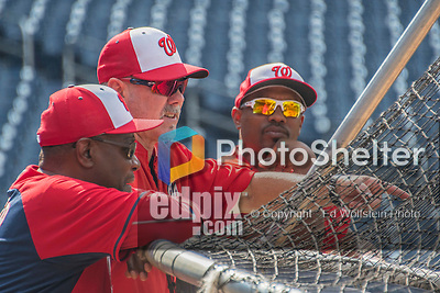 23 July 2016: Washington Nationals hitting coach Rick Schu (center) chats with assistant hitting coach Jacque Jones (right) and Manager Dusty Baker prior to a game against the San Diego Padres at Nationals Park in Washington, DC. The Nationals defeated the Padres 3-2 on a Stephen Drew pinch-hit, walk-off triple in the bottom of the 9th inning to tie their series at one game apiece. Mandatory Credit: Ed Wolfstein Photo *** RAW (NEF) Image File Available ***