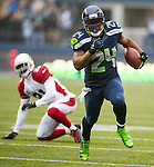 Seattle Seahawks running back Marshawn Lynch (25) iooks for running room against the Arizona Cardinals defense during the 2nd quarter at CenturyLink Field in Seattle, Washington on December 22, 2013.   Lynch rushed for 71 yards on 18 carries in the Seahawks 10-17 loss to the Cardinals.  ©2013. Jim Bryant Photo. ALL RIGHTS RESERVED.
