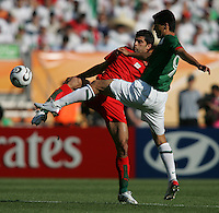 JUNE 11, 2006: Nuremberg, Germany: Mexican forward (9) Jared Borgetti fights for possession with Iranian defender (5) Rahman Rezaei during the World Cup Finals at Franken-Stadion in Nuremberg, Germany.  Mexico defeated Iran, 3-1.
