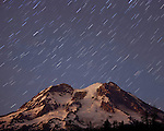 A five minute timed exposure creates an effect resembling a shower of stars over the beautifully fading hues of post sunset light on Mt. Rainier.
