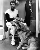 "San Francisco Giants outfielder Bobby Bonds in the locker room with his dog ""Ringo"". .(1974 photo by Ron Riesterer)"