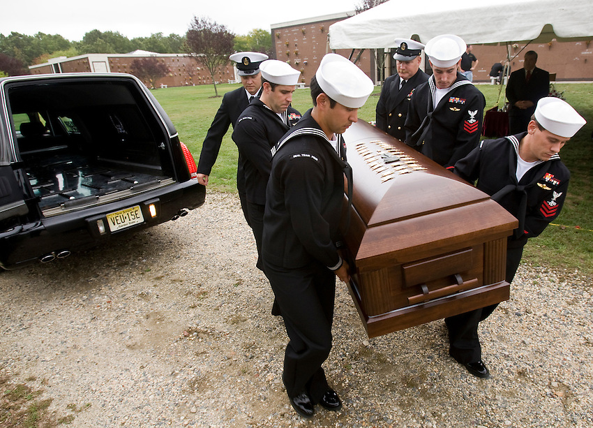 TOMS RIVER, N.J. --US Navy Seals remove the casket carrying the remains of their fallen comrade, Denis Miranda, after his funeral at Ocean County Memorial Park. Miranda, 24, a Seal from Toms River, was killed in a helicopter crash in southern Afghanistan last week.  (9/30/2010)  photo by Andrew Mills/The Star-Ledger.. Sent DIRECT TO SELECTS Thursday, September 30, 2010 14:54:15 5466 3941
