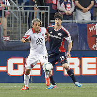 D.C. United midfielder Nick DeLeon (18) controls the ball as New England Revolution defender Stephen McCarthy (15) pressures. In a Major League Soccer (MLS) match, the New England Revolution (blue) tied D.C. United (white), 0-0, at Gillette Stadium on June 8, 2013.
