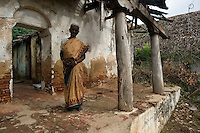 Woman at abandoned house on road between Nagapattinam and Nagore.<br /> Tamil Nadu. South India.