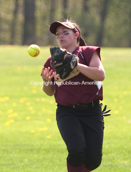 WATERBURY, CT--050815JS03- Sacred Heart's Kaitlynn Keeley (17) has a  a fly pop out of her glove during their game against Holy Cross Friday at Holy Cross High School in Waterbury. <br /> Jim Shannon Republican-American