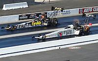 Nov 13, 2016; Pomona, CA, USA; NHRA top fuel driver Antron Brown (near) alongside Leah Pritchett during the Auto Club Finals at Auto Club Raceway at Pomona. Mandatory Credit: Mark J. Rebilas-USA TODAY Sports