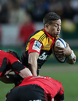 Chiefs' Tim Nanai-Williams makes a run past Crusaders' Matt Todd and Samuel Whitelock in the semi-final Super Rugby match, Waikato Stadium, Hamilton, New Zealand, Friday, July 27, 2012.  Credit:SNPA / David Rowland