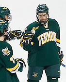 Tobias Nilsson-Roos (Vermont - 24) joins fellow starters Josh Burrows (Vermont - 22) and Jack Downing (Vermont - 21) on the blue line. - The Boston College Eagles defeated the visiting University of Vermont Catamounts 6-0 on Sunday, November 28, 2010, at Conte Forum in Chestnut Hill, Massachusetts.