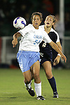 9 November 2007: North Carolina's Casey Nogueira (54) maintains position between the ball and Virginia's Alli Fries (8). The University of North Carolina tied the University of Virginia 1-1 at the Disney Wide World of Sports complex in Orlando, FL in an Atlantic Coast Conference tournament semifinal match.  UNC advanced to the finals on penalty kicks, 4-2.