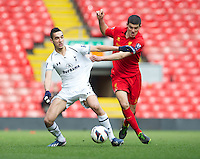 LIVERPOOL, ENGLAND - Easter Monday, April 1, 2013: Liverpool's captain Conor Coady in action against Tottenham Hotspur's Nabil Bentaleb during the Under 21 FA Premier League match at Anfield. (Pic by David Rawcliffe/Propaganda)
