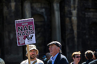 Saturday, May 26, 2012. .Anti-fascism march organised by United Against Fascism (UAF) antagonising a march by the far-right Scottish Defence League (SPL). .The two groups ended their marches on opposite sides of Reagent Street, Edinburgh, Scotland, where St Andrew's House is located.  .A strong police presence, hundreds of officers, separated the two groups.