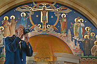 A man photographs the interior of St. Paul's Catholic Church in Westerville during an open house for the new church. Behind him is the mural above the tabernacle.