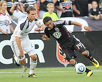 Andy Najar #14 of D.C. United leans into Todd Dunivant #2 of the Los Angeles Galaxy during an MLS match at RFK Stadium on July 18 2010, in Washington D.C. Galaxy won 2-1.