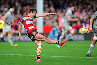 Billy Burns of Gloucester Rugby puts boot to ball. Aviva Premiership match, between Gloucester Rugby and Bath Rugby on October 1, 2016 at Kingsholm Stadium in Gloucester, England. Photo by: Patrick Khachfe / Onside Images