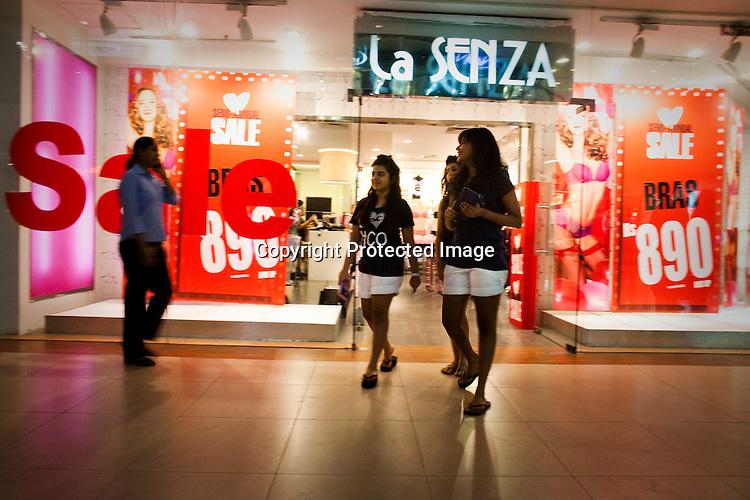 Upper class Indian women seen shopping in a mall in New Delhi, India..Photograph: Sanjit Das/Panos