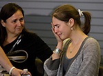 Amanda Knox, right, breaks down as her mother, Edda, looks on during a news conference held  at the Seattle-Tacoma International Airport near Seattle, Washington on October 4, 2011. Knox arrived in the United States after departing Rome's Leonardo da Vinci airport,. Knox's life turned around dramatically Monday when an Italian appeals court threw out her conviction in the sexual assault and fatal stabbing of her British roommate.  ©2011. Jim Bryant Photo. All Rights Reserved.