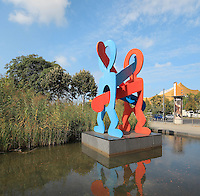The Boxers, steel sculpture, 1998, by Keith Haring, 1958-90, on Eichhornstrasse outside the Grand Hyatt Hotel on Potsdamer Platz, Berlin, Germany.  Picture by Manuel Cohen