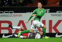 FUSSBALL   1. BUNDESLIGA   SAISON 2011/2012    14. SPIELTAG SV Werder Bremen - VfB Stuttgart       27.11.2011 Marko ARNAUTOVIC (vorn, Bremen) gegen Serdar TASCI (Stuttgart)