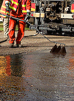 Spraying road tar during resurfacing work Larger JPEGS and TIFFs available. Contact us via  www.photograhy4business.com