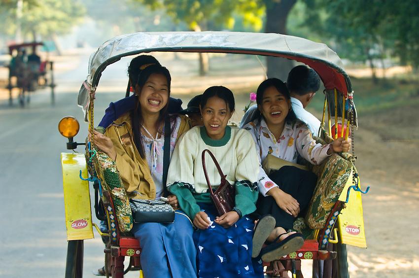 Burmese women riding in a horse cart, Bagan, Myanmar (Burma)
