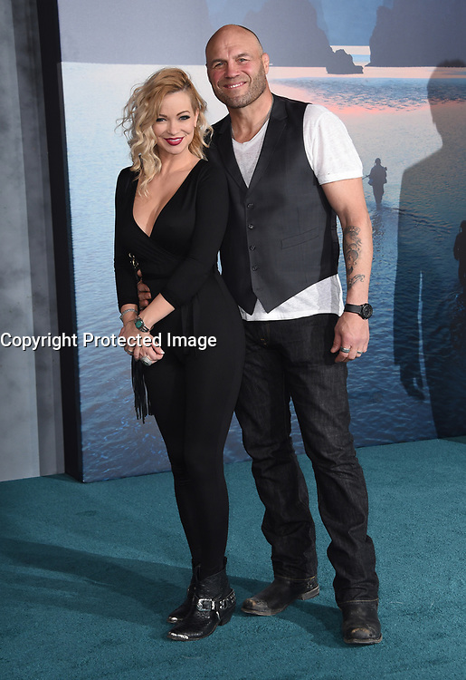 Randy Couture + Mindy Robinson @ the Los Angeles premiere of 'Kong: Skull Island' held @ the Dolby theatre.<br /> March 8, 2017 , Hollywood, USA. # PREMIERE DU FILM 'KONG : SKULL ISLAND' A LOS ANGELES
