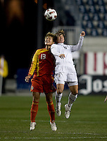 Amy LePeilbet (6) of the USWNT goes up for a header with Ma Jun (13) of China during an international friendly at PPL Park in Chester, PA.  The U.S. tied China, 1-1.