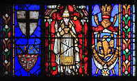Stained glass window of donor and coats of arms, 1854, by Alfred Gerente, 1821-68, in the apsidal chapel of St Theodosie, at the Basilique Cathedrale Notre-Dame d'Amiens or Cathedral Basilica of Our Lady of Amiens, built 1220-70 in Gothic style, Amiens, Picardy, France. Alfred Gerente designed the chapel and included portraits of Napoleon III and Eugenie to commemorate their visit to the chapel in 1853. Amiens Cathedral was listed as a UNESCO World Heritage Site in 1981. Picture by Manuel Cohen