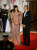 President Barack Obama and First Lady Michelle Obama wait for Prime Minister of Italy Matteo Renzi and Mrs. Agnese Landini to arrive at the North Portico  of the White House on October 18, 2016 in Washington, DC.<br /> Credit: Olivier Douliery / Pool via CNP