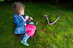 "Young girl ""charming"" a foxglove snake"