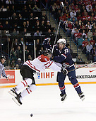 Marco Scandella (Canada - 5), Kyle Palmieri (USA - 23) - Team Canada defeated Team USA 5-4 (SO) on Thursday, December 31, 2009, at the Credit Union Centre in Saskatoon, Saskatchewan, during the 2010 World Juniors tournament.