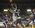 "Ole Miss center Demarco Cox (42) shoots in traffic at the C.M. ""Tad"" Smith Coliseum in Oxford, Miss. on Thursday, December 29, 2010. (AP Photo/Oxford Eagle, Bruce Newman)"