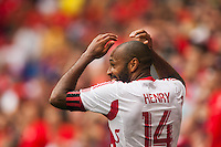 Thierry Henry (14) of the New York Red Bulls reacts to missing a shot. The New York Red Bulls defeated the Houston Dynamo 2-0 during a Major League Soccer (MLS) match at Red Bull Arena in Harrison, NJ, on June 30, 2013.